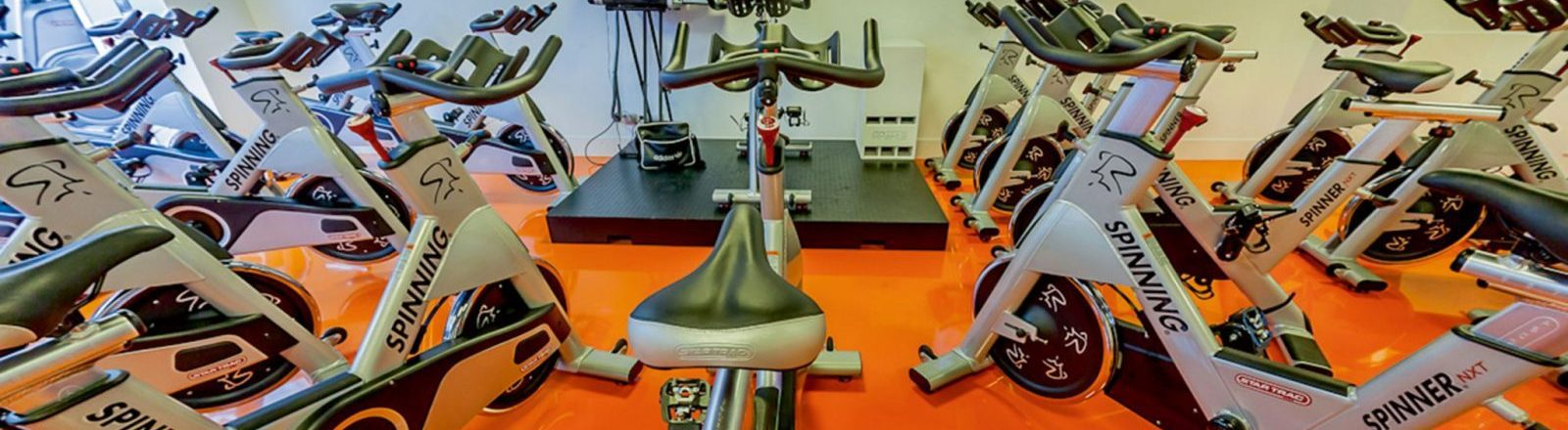 Spinning class with orange flooring in Birmingham